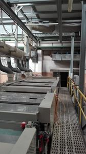 Automatic line for the application of galvanic zinc on steel parts on hinges.